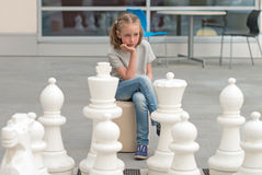 Little girl playing chess game. Royalty Free Stock Photos