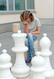 Little girl playing chess game. Stock Photos