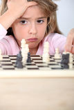 Little girl playing chess Royalty Free Stock Photography