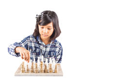 Little Girl Playing Chess II Stock Images