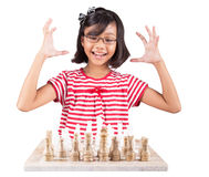 Little Girl Playing Chess IV Stock Photography