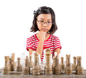 Little Girl Playing Chess VII Stock Photos
