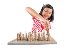 Little Girl Playing Chess VIII Royalty Free Stock Photos
