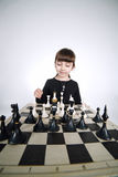 Little girl playing chess on white Royalty Free Stock Photo