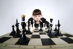 Little girl playing chess on white Stock Photo