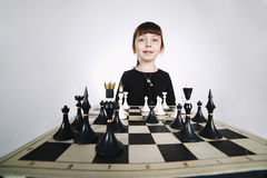 Little girl playing chess on white Stock Photography
