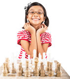 Little Girl Playing Chess XII Stock Image