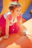 Little girl playing. With children Stock Images