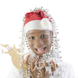 Little girl playing with Christmas decorations Stock Image
