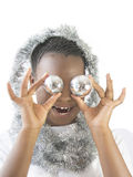 Little girl playing with Christmas decorations Royalty Free Stock Images