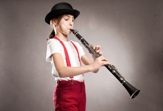 Little girl playing clarinet Royalty Free Stock Images