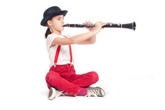 Little girl playing clarinet Stock Images