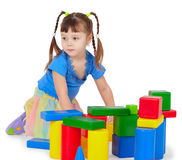 Little girl is playing with color bricks. The little girl is playing with colored bricks Royalty Free Stock Photography