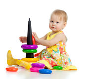 Little girl playing with color toy Stock Photos