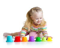 Little girl playing with color toys Royalty Free Stock Photos