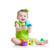 Little girl playing with color toys Royalty Free Stock Images