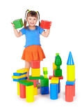 Little girl is playing with colored blocks Stock Image