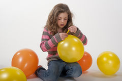 Little girl playing with colorful balloons Stock Images