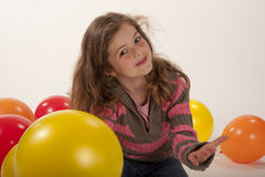 Little girl playing with colorful balloons Royalty Free Stock Photography