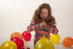 Little girl playing with colorful balloons Stock Photos