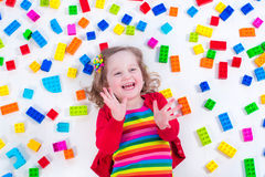 Little girl playing with colorful blocks Royalty Free Stock Photo