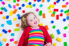 Little girl playing with colorful blocks Stock Images