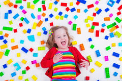 Little girl playing with colorful blocks Royalty Free Stock Photos