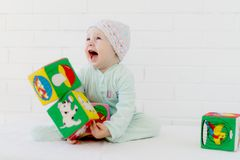 Cute baby playing and laughing royalty free stock photography