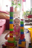 Little girl playing with colorful plastic blocks Royalty Free Stock Images