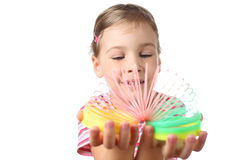 Little girl playing with colorful plastic spring Stock Photography