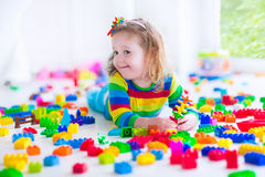 Little girl playing with colorful toy blocks Royalty Free Stock Images