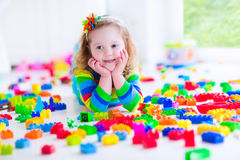 Little girl playing with colorful toy blocks Stock Photography