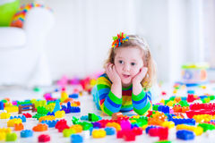 Little girl playing with colorful toy blocks Royalty Free Stock Photography