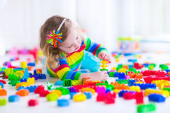 Little girl playing with colorful toy blocks Royalty Free Stock Image