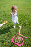 Little Girl Playing with Colorful Wooden Rings Stock Image