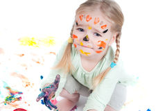 Little girl playing with colors Stock Image