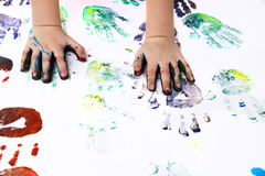 Girl playing with colors - detail of hands Royalty Free Stock Photography