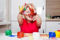 Little girl playing with colors Stock Photography