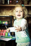 Little girl playing with colors Royalty Free Stock Photo