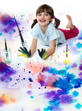 Little girl playing with colors. Happy little girl playing with colors royalty free stock photos