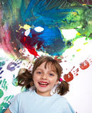 Little girl playing with colors Royalty Free Stock Photos