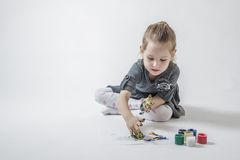 Little Girl Playing With Colors Stock Photo