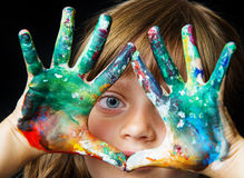 Little girl playing with colors Royalty Free Stock Images