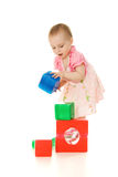 The little girl playing with colourful blocks Stock Photos