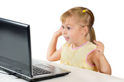 Little girl playing on the computer Stock Photography