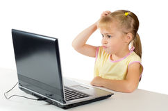 Little girl playing on the computer Royalty Free Stock Photos