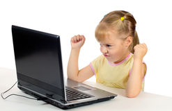 Little girl playing on the computer. Royalty Free Stock Photography