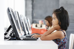 Little girl playing computer Stock Photo