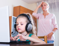 Little girl playing computer game Royalty Free Stock Photo