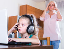 Little girl playing computer game Royalty Free Stock Photos